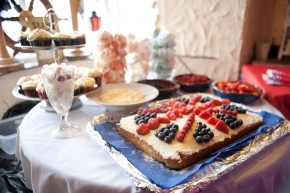 A jubilee cake covered in blueberries and raspberries
